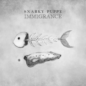Snarky Puppy - Immigrance (GrounUP Music, 2019) di Paolo Guidone